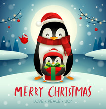 Adult Penguin And Baby Penguin Under The Moonlight In Christmas Snow Scene.