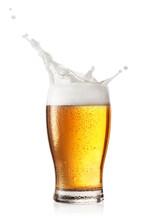 Splash Of Foam In Glass Of Beer