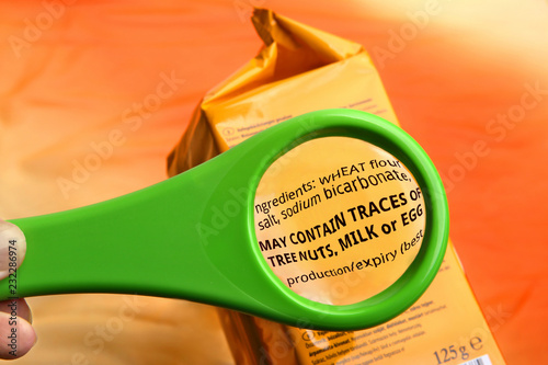 Fototapeta Empty magnifying glass on food additives label with copy space for your text
