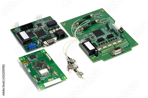 Fotografía  Set of electronic printed circuit boards with optic connectors attached and othe