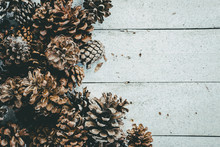 Pine Cone With Whithe Wooden Background