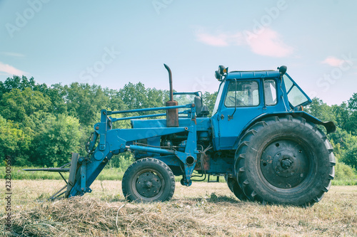 Tractor for working in the field and mowing grass