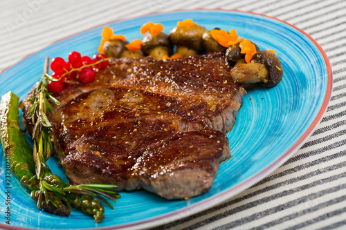 Fotografie, Obraz  Steak entrecote of beef with mushroom and asparagus at plate