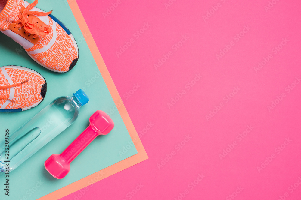 Fototapeta Flat lay with sport equipment on pink background