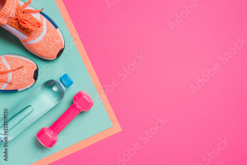 Valokuva Flat lay with sport equipment on pink background