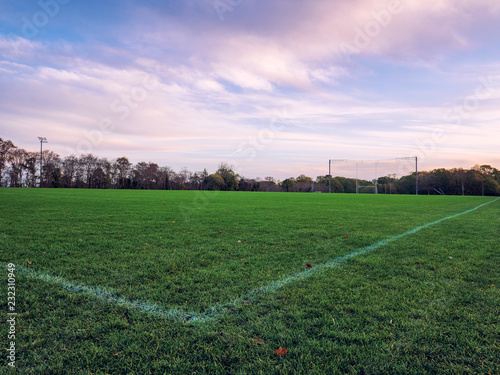 Foto auf Acrylglas Schwan wide angle shot the cornor of football filed on morning time