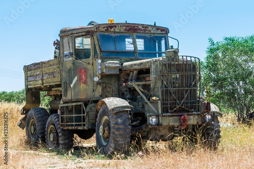 Old green truck on blue sky background
