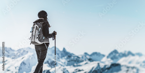 Staande foto Wanddecoratie met eigen foto Athletic woman trekking in a winter landscape