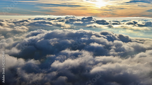 Fototapeta  Above the clouds, paragliding in the autumn light of the November sun