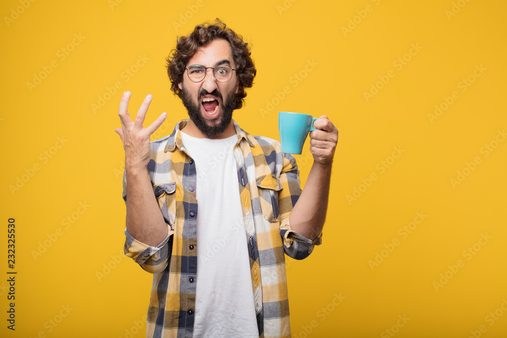 Fototapety, obrazy: young crazy mad man  fool pose with a coffee.