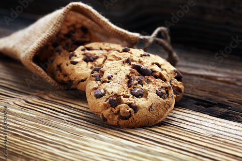 Foto op Plexiglas Koekjes Chocolate cookies on wooden table. Chocolate chip cookies shot.