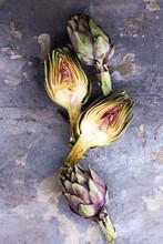 Artichokes On Grey Background. Fresh Organic Artichoke Flower.