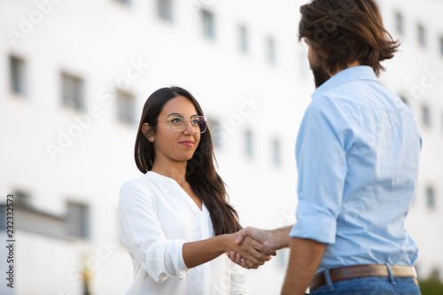 Canvas Prints Textures Successful partners shaking hands on meeting at office building. Professional multicultural businesspeople having meeting in city. Handshake concept