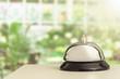 Vintage hotel reception service desk bell on blurred background