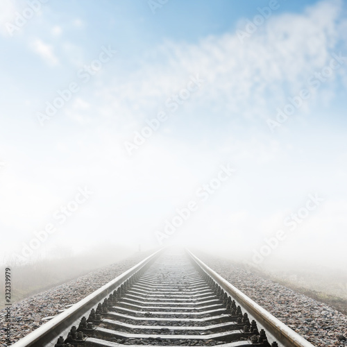 railroad closeup goes to horizon in fog