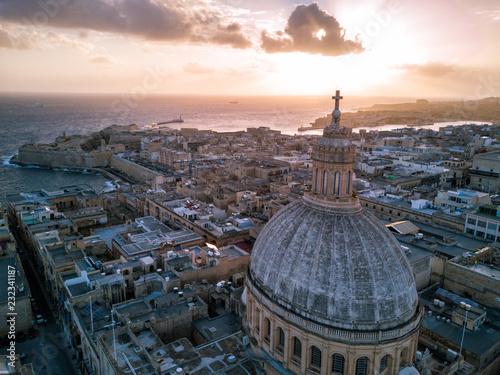 Fotografie, Obraz  Aerial drone sunrise photo over Our Lady of Mount Carmel basilica