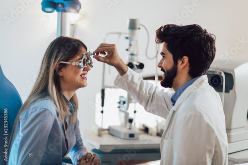 Fotografia, Obraz  Optometrist checking patient eyesight and vision correction