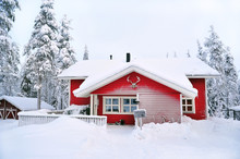 Red Wooden House In A Snow Cov...