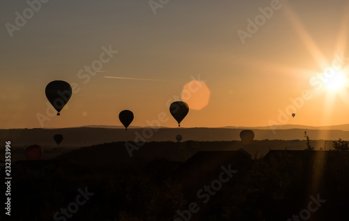 Foto op Canvas Luchtsport Balloon in the sunset