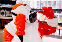 Santa Claus In Appliance Store In Red