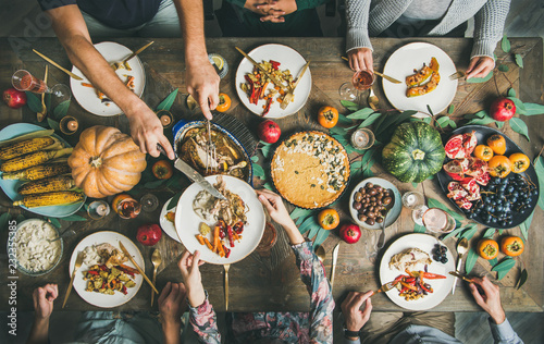 In de dag Assortiment Traditional Thanksgiving day celebration party. Flat-lay of Friends or family eating different snacks and turkey at Festive Christmas table, top view