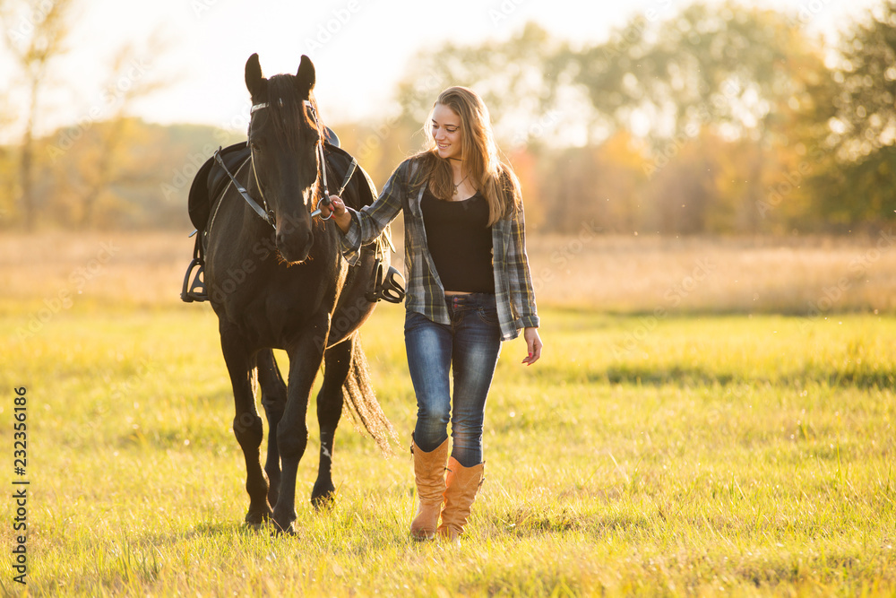 Fototapety, obrazy: Girl horse rider stands near the horse and hugs the horse. Horse theme