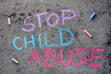 Colorful Chalk Drawing On Asphalt: Words STOP CHILD ABUSE