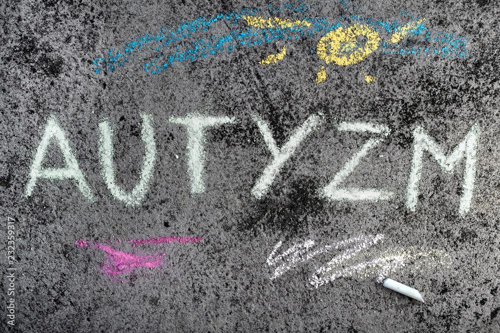 Fototapeta Kolorowy rysunek wykonany kreda na chodniku: Napis AUTYZM