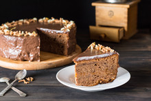 Piece Of Chocolate Cake On A White Plate On Wooden. Traditional Austrian Cake. Cake. Apricot Pie. Breakfast Concept. Coffee Time. Still Life Of Food. Chocolate Decoration. Christmas Cake.
