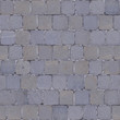 A fragment of wall covered with ceramic tiles