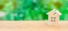 A Wooden House With A Crack. The Concept Of A Damaged House, Dilapidated Housing. Renovation, Repair And Restoration Of The Old Building. Property Insurance. Weather Element. Damage.
