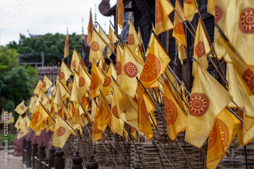 Fotografia  Thammachak flags at temple in Chiang Mai, Thailand
