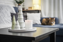 Christmas Decorations With Candle On Coffee Table