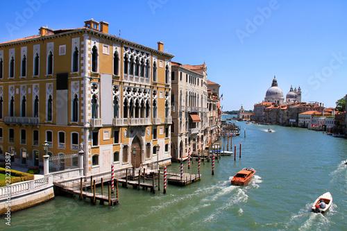 Foto op Plexiglas Venetie Venice Canal Boat Traffic and Mooring Posts