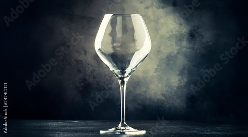 Empty wine glass for red wine, gray background, selective focus