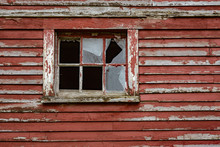 Weathered Red Paint And Broken Windows Are A Common Site On Barns