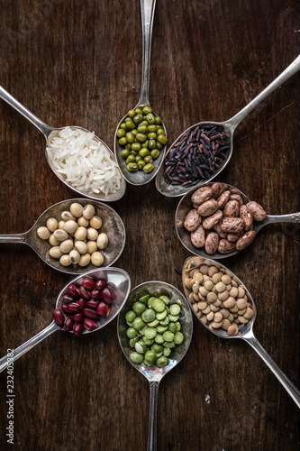 Foto op Canvas Aromatische Various types of beans on spoons