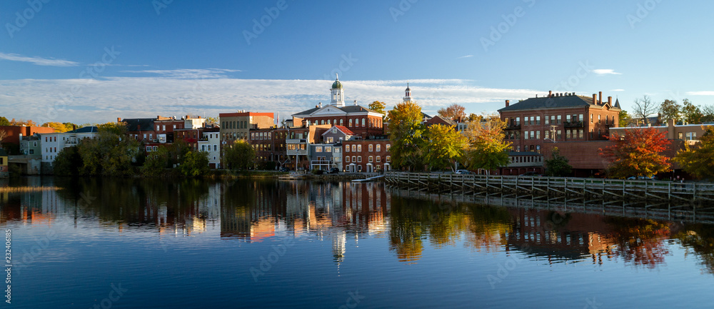 Fototapety, obrazy: The river front buildings are seen reflected in the water