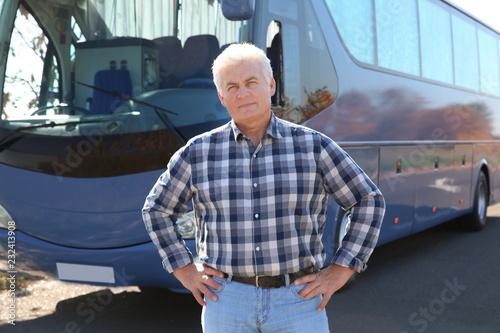 Professional driver standing near bus. Passenger transportation