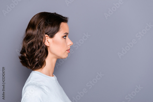Valokuva  Close up portrait of pretty lady with her modern haircut she sta