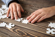 Woman doing puzzle at table, closeup