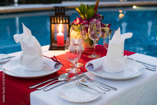 Romantic Candlelit Dinner Table; Poolside with Table Set.