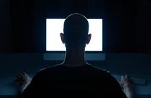 Man With Criminal Intentions Hacking From A Desktop Computer.