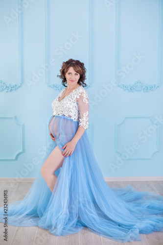 b43c6f16d4a Beautiful pregnant young woman wearing luxury blue lingerie dress ...
