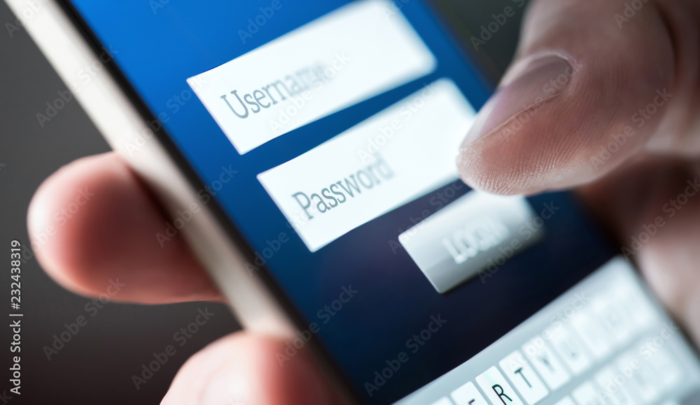 Fototapeta Login with smartphone. Username and password. Registration to website. Personal security. Online bank or personal information. Identity theft, scam or fraud. Macro close up of phone screen.
