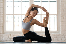 Young Sporty Attractive Woman Practicing Yoga, Doing Mermaid Exercise, Eka Pada Rajakapotasana Pose, Working Out, Wearing Sportswear, Pants And Top, Indoor Full Length, White Yoga Studio