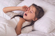 Close up of girl yawning in bed