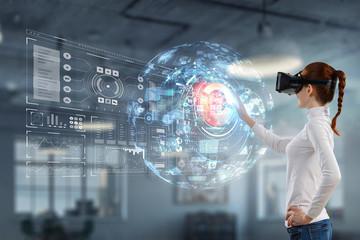 Fototapeta Experiencing virtual technology world. Mixed media
