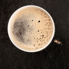 An Overhead Photo Of Black Coffee In A Vintage Cup, On A Black Background With Copy Space