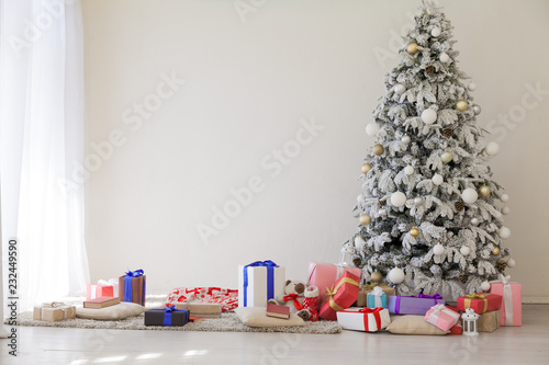 Spoed Foto op Canvas Bomen Christmas tree with presents, lights new year winter holidays